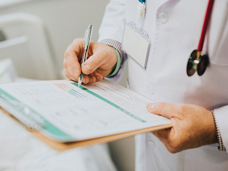 Doctor reviewing a patient's chart